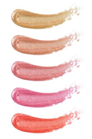 Verschillende lipgloss op wit wordt geïsoleerd Stockfoto
