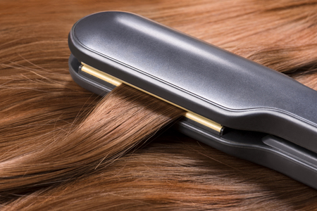 Straightening long red hair with hair irons