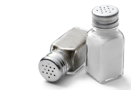 white pepper: Salt and pepper shakers on a white background