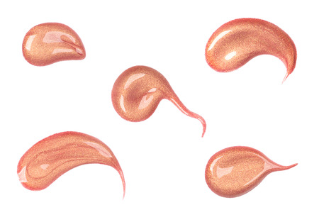 gloss: Collection of various strokes of lip gloss on white background Stock Photo