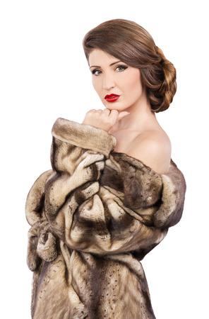 fur coat: Beautiful woman in fur coat looking at camera