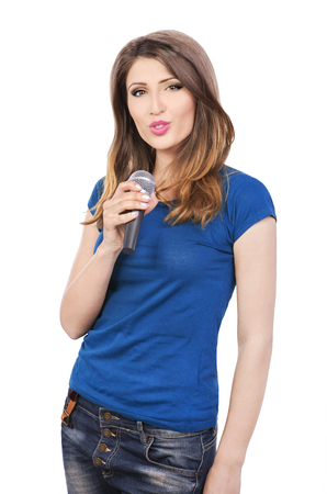 preety: Preety woman singing into a microphone Stock Photo