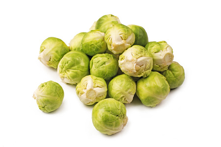 A pile of Brussels sprouts on a white background Stock Photo