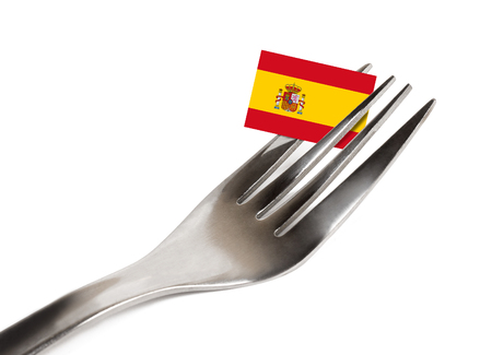 Fork on white background with flag of Spain
