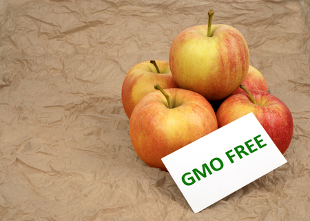 Fresh apples with the card GMO Free