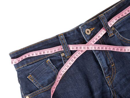 Jeans and pink measuring tape on white background. Stok Fotoğraf