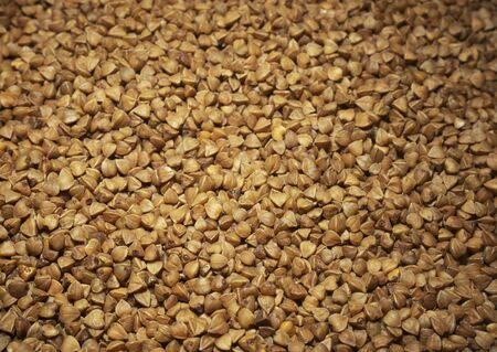Buckwheat background. Roasted buckwheat. Healthy food.
