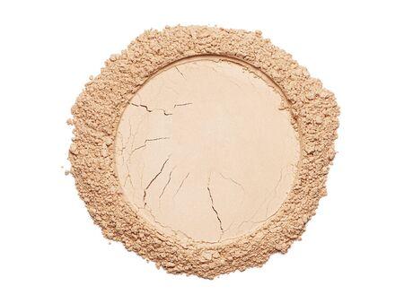Circle of a broken make up powder on white background