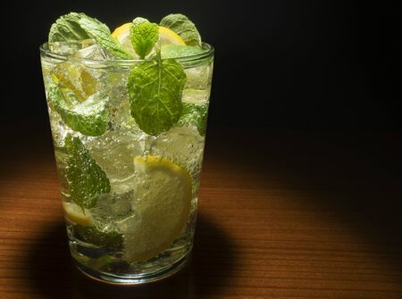 The glass of cocktail garnished with lemon and mint Stok Fotoğraf