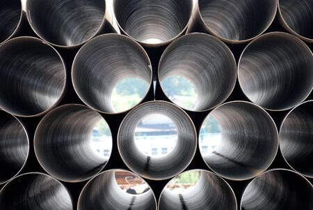Stack of iron pipes. Industrial material Standard-Bild