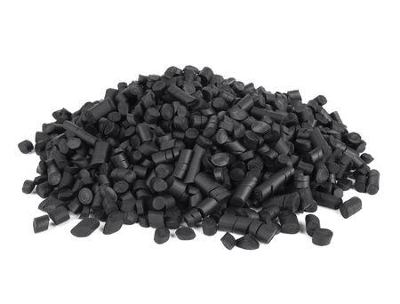 Pile of black rubber granules on white white background