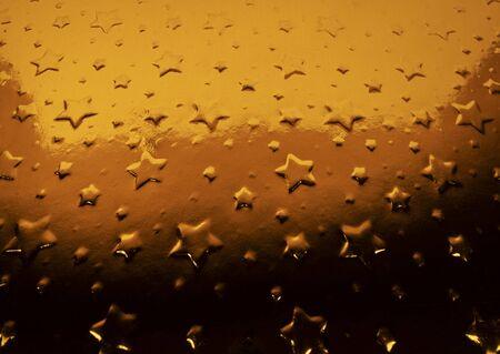Close-up golden metallic stars background