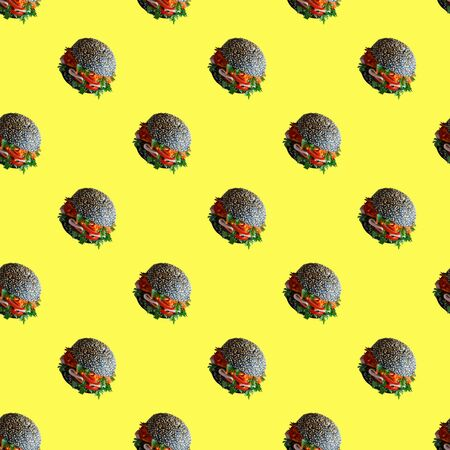Seamless pattern of the burgers on a yellow background. Isometric concept. Stock Photo