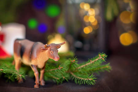 Toy Bull on the branches of the spruce Stock fotó