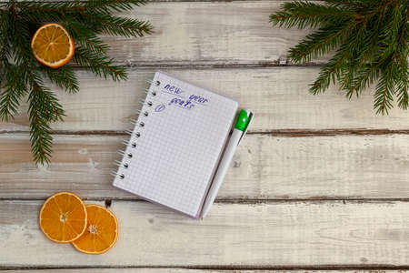 Christmas tree and holiday decorations. List of goals for the new year. New year and christmas concept. View from above.