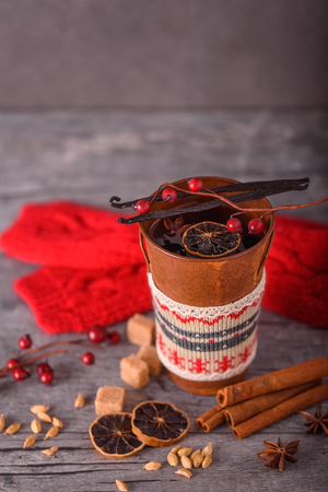 Winter mulled wine in a rustic metal mug on a grey wooden background Stock Photo