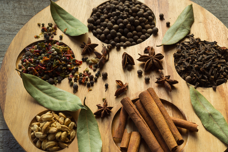Still life with spices: cinnamon sticks, allspice, Bay leaf, cloves, anise, badian.