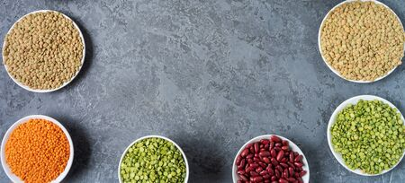 Top view of assortment of peas, lentils, beans and legumes over gray background, with copy space. 版權商用圖片