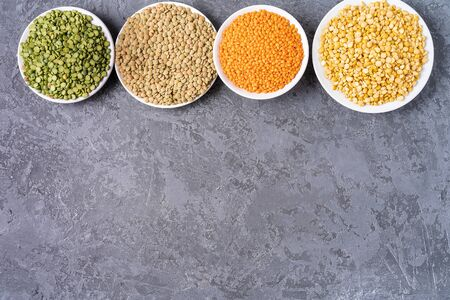 Top view of assortment of peas, lentils, beans and legumes over gray background, with copy space. Stock Photo