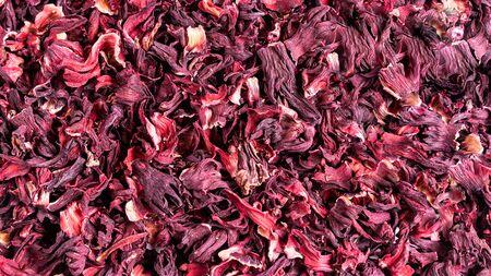 Dry red herbal hibiscus karkade leaf tea as background. Zdjęcie Seryjne