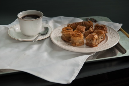 Desserts plate with a cup of coffee on a tray . photo