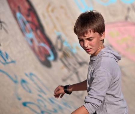 Boy rides his skateboard .Half-length portrait. Focus on the boys face. photo