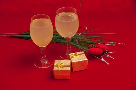 Holiday  decorated  with wine on gold background . photo