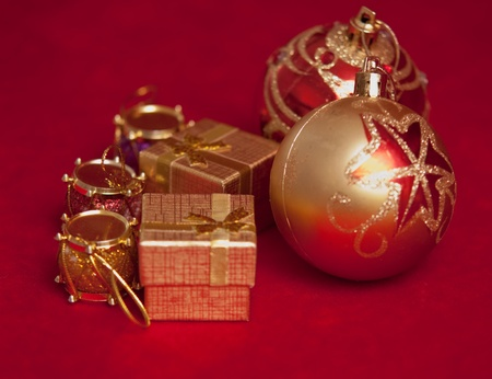 Varicoloured christmas balls on red  background  . Stock Photo - 9554380