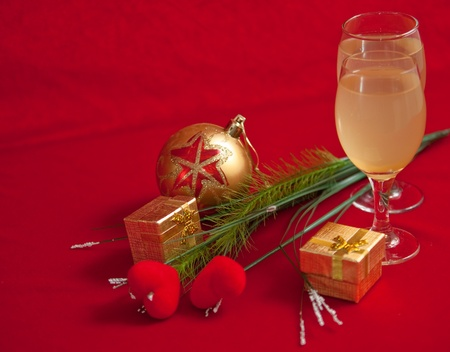 Christmas balloon  and wine on red background . photo