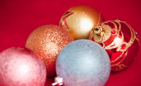 Varicoloured christmas balls on red  background  . Stock Photo - 9554432