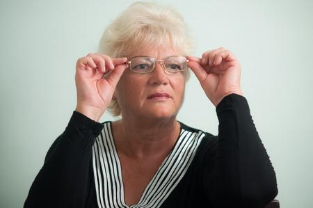 Closeup of a beautiful mature woman in glasses . Stock Photo