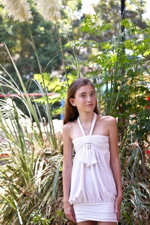 Portrait of a girl in a white dress in park . Stock Photo - 9549120