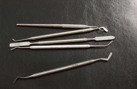 Set of metal medical equipment tools for teeth dental care   photo
