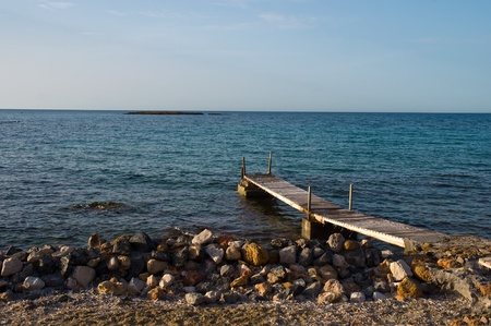 Wooden pier by the sea . photo