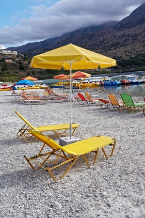 Sunbeds on a shore of Kournas lake. photo