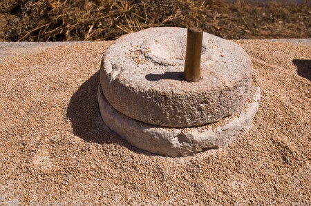 The ancient, stone, hand grain mill.