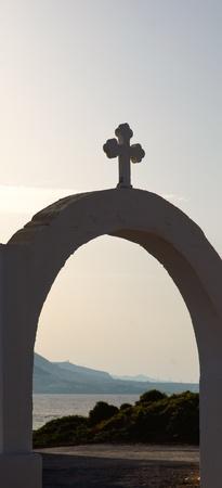 Views of the coast of Crete through the gates of the Greek Church. photo