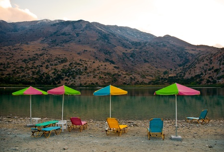 Sunbeds on a shore of Kournas lake. Crete, Greece . Stock Photo - 9554664