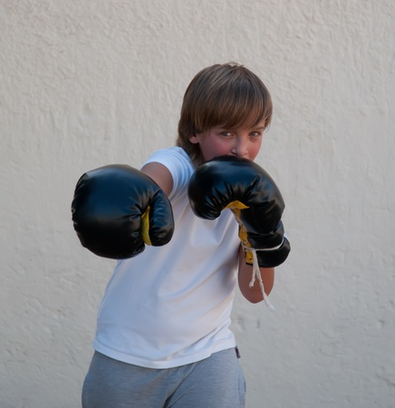 The boy in boxing gloves . photo