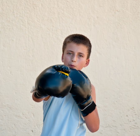 The boy in boxing gloves .