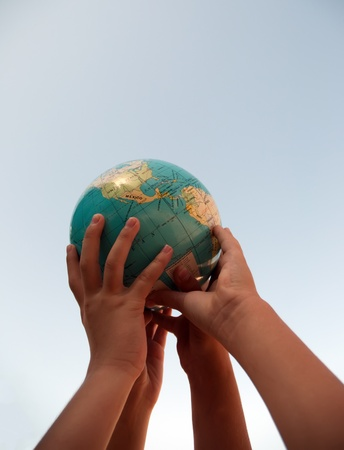 The globe in childrens hands. photo