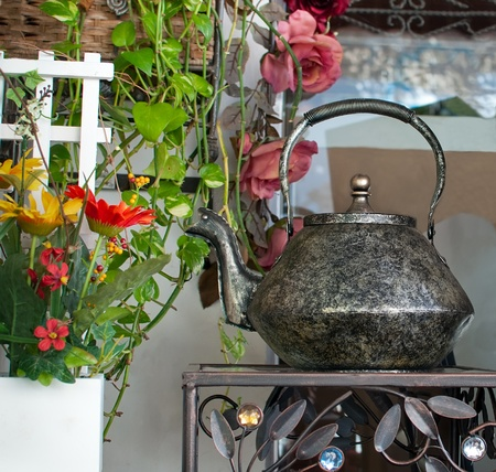 Details of the interior with decorative kettle . Stock Photo