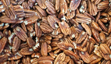 Bunch of pecan nuts background .