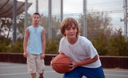 Teenagers play basketball  . photo