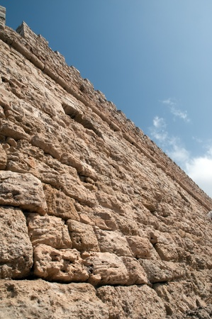 ramparts: The wall of an ancient fortress .