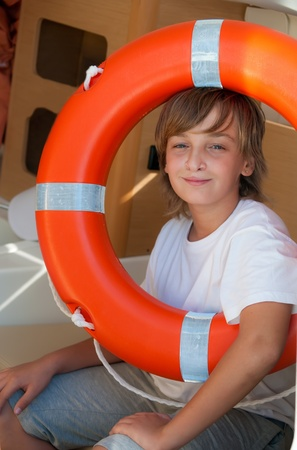 Boy in the life preserver on a yacht . Stock Photo - 9554696