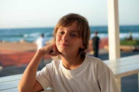 Portrait of a boy in the outdoor cafes. photo