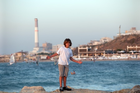 Portrait of a boy on the docks at the yacht club in Tel Aviv. photo