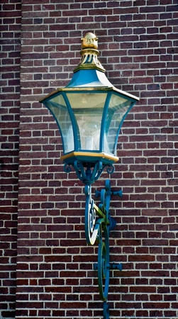 Classic lantern on a brick wall . photo