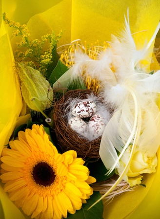 Colorful easter eggs and beautiful flowers (easter composition) . photo